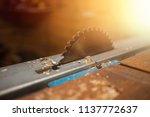 Saws details of furniture with a circular saw. Tinted image. close up. circular saw for cutting wood. - stock photo