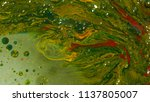 oil colors mixing on water    Shutterstock . vector #1137805007