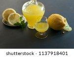 bottle of limoncello and lemons ... | Shutterstock . vector #1137918401