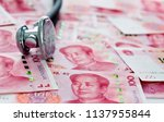 stethoscope on heap of chinese...   Shutterstock . vector #1137955844