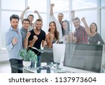 happy business team standing in ... | Shutterstock . vector #1137973604