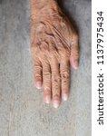 elderly hand wrinkled on old...   Shutterstock . vector #1137975434