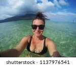 young happy tourist woman... | Shutterstock . vector #1137976541
