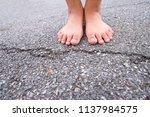 dirty bare feet of children...   Shutterstock . vector #1137984575