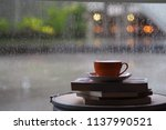 a coffee cup over window glass... | Shutterstock . vector #1137990521