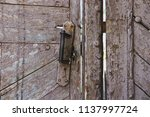 an old wooden gate with a rusty ... | Shutterstock . vector #1137997724