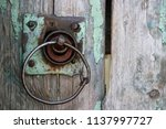 an old wooden gate with a round ... | Shutterstock . vector #1137997727
