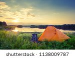 orange tent and backpack on the ... | Shutterstock . vector #1138009787