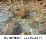 stones on the beach of the... | Shutterstock . vector #1138015979