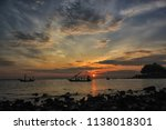 a fisherman is coming home... | Shutterstock . vector #1138018301