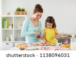 family  cooking and people... | Shutterstock . vector #1138096031