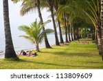 KOH CHANG, THAILAND - MARCH 12: Tourists relaxing on the beach on Koh Chang island on March 12, 2012. Almost 20 million tourists visited Thailand in 2011. - stock photo