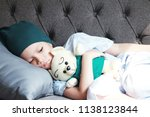 patient kid lie down on couch... | Shutterstock . vector #1138123844