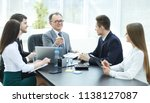 manager and business group... | Shutterstock . vector #1138127087
