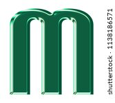 shiny green glass letter m in a ... | Shutterstock . vector #1138186571