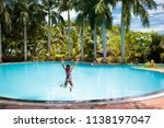 child with goggles in swimming... | Shutterstock . vector #1138197047