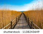 wooden bridge walkway path on...   Shutterstock . vector #1138243649