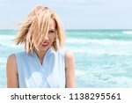 a middle aged woman smiles with ...   Shutterstock . vector #1138295561