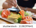 chopsticks on sushi on top of... | Shutterstock . vector #1138299641