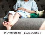 legs of patient kid in blue... | Shutterstock . vector #1138300517