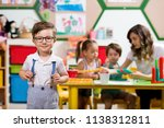 preschooler boy posing at... | Shutterstock . vector #1138312811