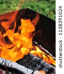 burning firewood in a brazier | Shutterstock . vector #1138391024
