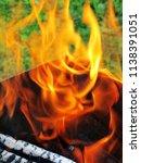 burning firewood in a brazier | Shutterstock . vector #1138391051