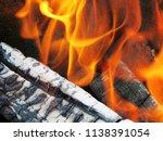 burning firewood in a brazier | Shutterstock . vector #1138391054
