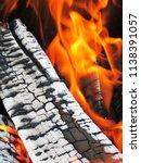 burning firewood in a brazier | Shutterstock . vector #1138391057