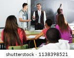 students listening the... | Shutterstock . vector #1138398521