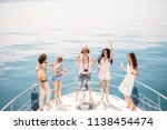 luxury vacation. joyful young... | Shutterstock . vector #1138454474