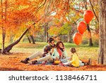 young family sitting on a... | Shutterstock . vector #1138466711