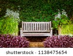 A Wooden Bench In The Garden...
