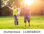 young family with children... | Shutterstock . vector #1138568024