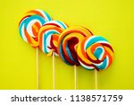 colorful hard candy lollipop on ... | Shutterstock . vector #1138571759