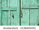 a very old  vintage  green door | Shutterstock . vector #1138604441