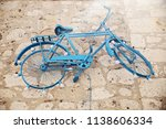blue  vintage bicycle hanging... | Shutterstock . vector #1138606334