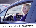young woman driving a car in... | Shutterstock . vector #1138627775