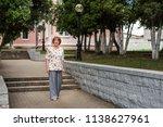 an elderly energetic lady... | Shutterstock . vector #1138627961