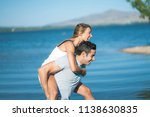 romantic couple playing... | Shutterstock . vector #1138630835