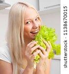 beautiful young blond woman... | Shutterstock . vector #1138670015