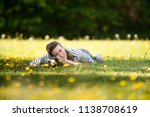 a cheerful  young woman lying... | Shutterstock . vector #1138708619