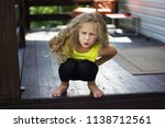a curly haired blonde little... | Shutterstock . vector #1138712561