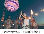 birthday girl hitting the... | Shutterstock . vector #1138717541
