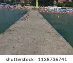 people are standing on the pier ... | Shutterstock . vector #1138736741