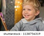 baby boy sitting in high chair... | Shutterstock . vector #1138756319