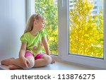 Cheerful Girl Sitting By The...