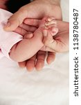 hands of a family  mother ... | Shutterstock . vector #1138780487