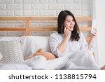 happy asian woman using... | Shutterstock . vector #1138815794