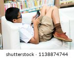 asian student is searching for... | Shutterstock . vector #1138874744